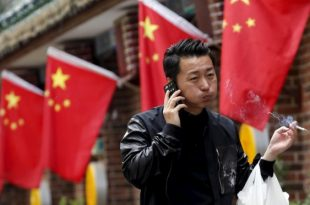 Beijing Bans Smoking in Public Places