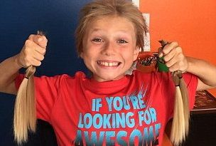 Bullied 8 year old boy grew out his hair for a good cause