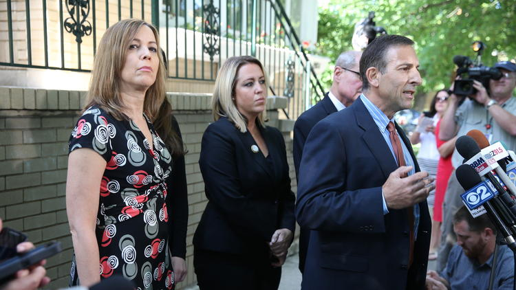 Patti Blagojevich, left, attends a news conference outside her home following the announcement that a federal appeals court in Chicago threw out five of 18 counts against Blagojevich. (Terrence Antonio James, Chicago Tribune)