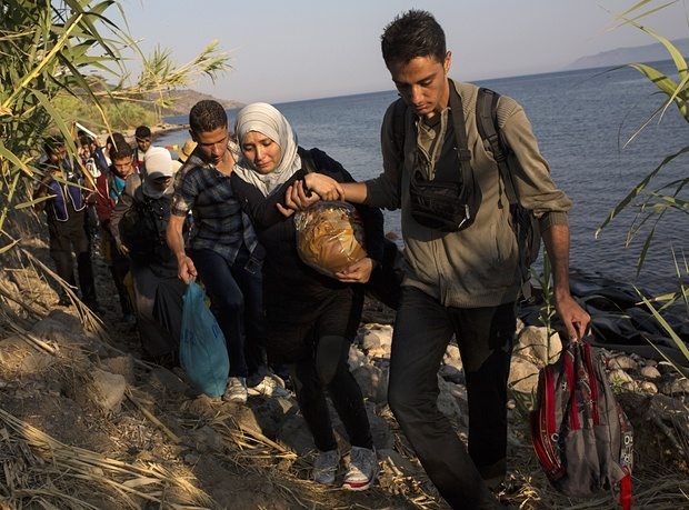 Migrants from Syria and Afghanistan arrive on the Greek island of Lesbos. Photograph: Santi Palacios/AP