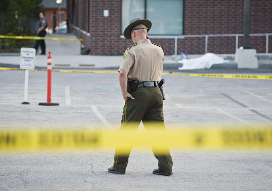 Vermont State police guard the scene of a fatal shooting behind Barre City Place Friday night. A Vermont Department for Children and Families worker was shot and killed by a mother after losing custody of her child, state officials say. (Photo: RYAN MERCER/FREE PRESS)