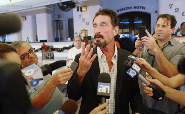 John McAfee talks to reporters in Miami Beach in late 2012 upon his return to America, after fleeing from Belize police during a murder investigation.