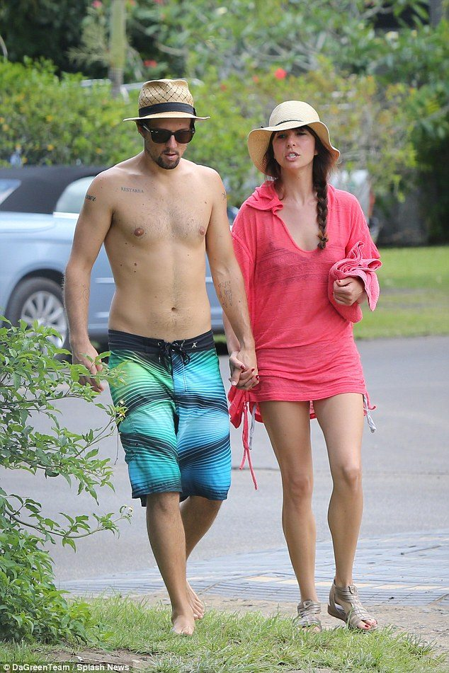 Romance: Jason met Christina in a cafe in Hermosa Beach, California in 2007 but they didn't start dating until 2011. The couple are pictured in Hawaii in 2013