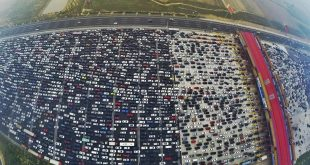 VIDEO Beijing, China: Thousands Left Stranded in 50-Lane Traffic Jam