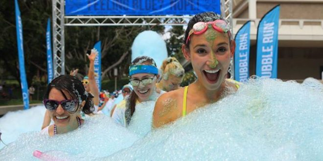 #BubbleRunNola Participants Run Through Colored Foam in 3-Mile Race in New Orleans