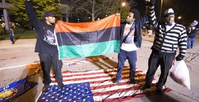 Black lives Matter Protestor Sets Fire to U.S. Flag; Raises Black Liberation Flag