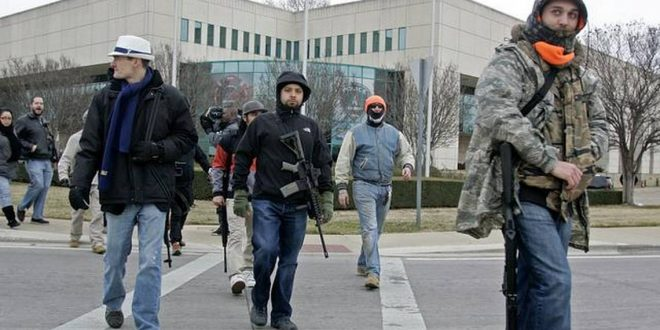 "FERGUSON, MO (KPLR) – About a dozen open-carry activists held a march to demonstrate their 2nd amendment rights in Ferguson. Members of the media appear to be outnumbering marchers to city hall on this rainy Monday. A Eureka gun shop owner organized the event. Sam Andrews tells the St. Louis Post-Dispatch that several black residents told him they would probably be shot if they tried to carry weapons in public. ""We intend to show that this right is not just for white people,"" said Andrews, who is white. County Executive Steve Stenger has criticized the group for holding the event. He says they are, ""inflaming a situation that is already inflamed."""