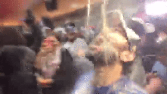 VIDEO Kansas City Royals Fan Paul Rudd Doused With Beer and Champagne by Royals Players