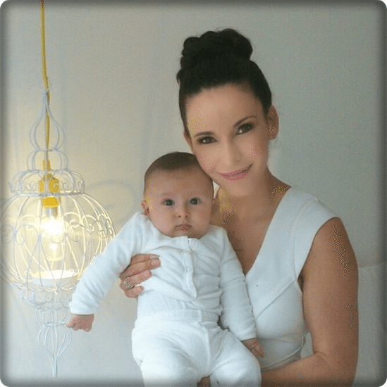 The telenovela actress poses with her son. Facebook/@AdrianaCampos
