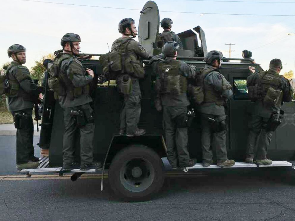 A police SWAT team conducts a manhunt after a mass shooting in San Bernadino, Calif., Dec. 2, 2015.