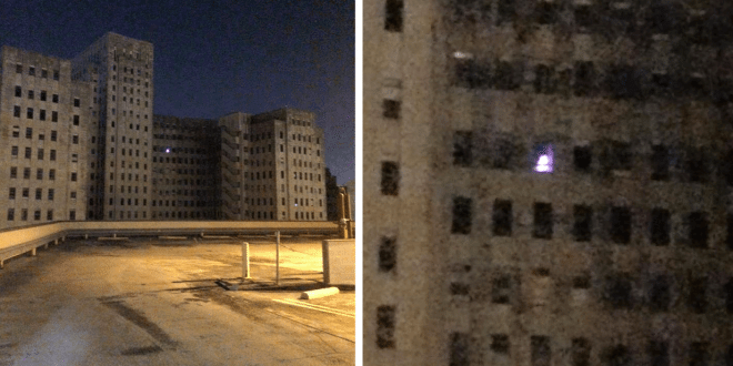 Christmas Tree Lights Up a Window from Abandoned Charity Hospital