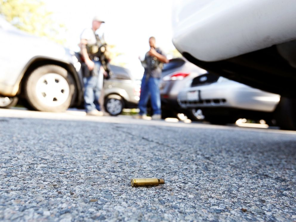 A spent cartridge lies on the ground as police officers secure the area after at least one person opened fire at a social services agency in San Bernardino, Calif., Dec. 2, 2015.