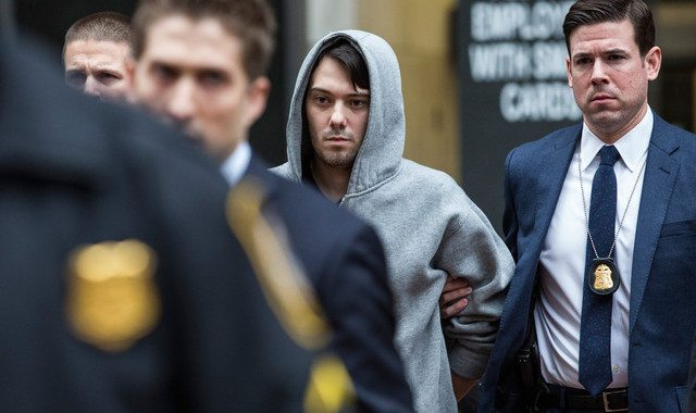 NEW YORK, NY - DECEMBER 17: Martin Shkreli (C), CEO of Turing Pharmaceutical, is brought out of 26 Federal Plaza by law enforcement officials after being arrested for securities fraud on December 17, 2015 in New York City. Shkreli gained notoriety earlier this year for raising the price of Daraprim, a medicine used to treat the parasitic condition of toxoplasmosis, from $13.50 to $750 though the arrest that happened early this morning does not involve that price hike. (Photo by Andrew Burton/Getty Images)