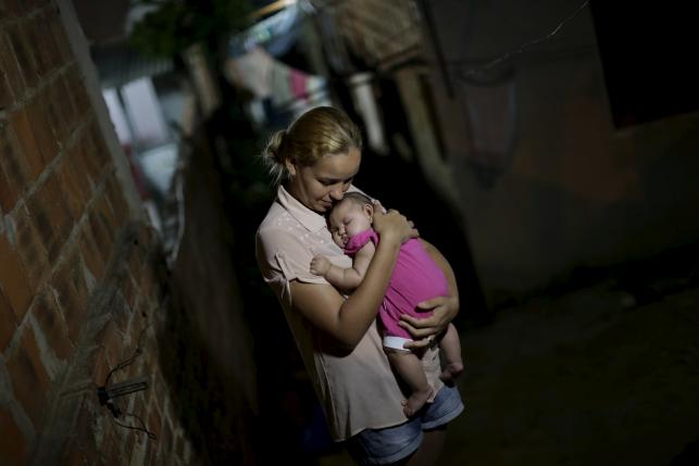 Gleyce Kelly embraces her daughter Maria Geovana, who has microcephaly, in Recife, Brazil, January 25, 2016.