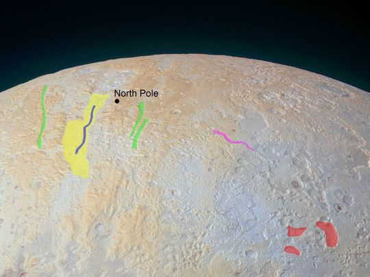 Long canyons can be seen running vertically across the polar area. The widest of the canyons is about 45 miles wide and runs close to the north pole. (Photo: NASA/JHUAPL/SwRI)