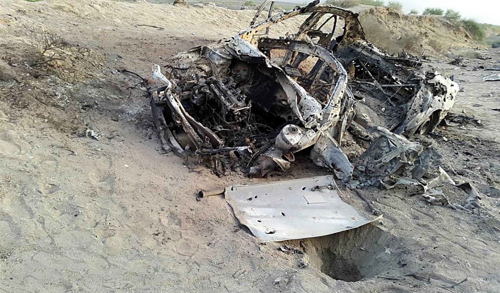 This photo taken by a freelance photographer Sunday purports to show the destroyed vehicle in which Mullah Mohammad Akhtar Mansoor was traveling. Abdul Salam Khan / AP