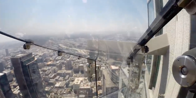 VIDEO AP Reporter Rides 1,000-Foot-High Glass Sky Slide in Los Angeles
