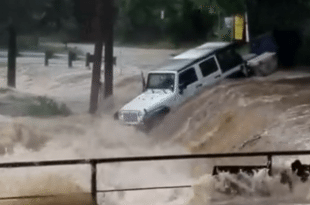 VIDEO Jeep Swept Away by Flood Waters in New Braunfels, Texas