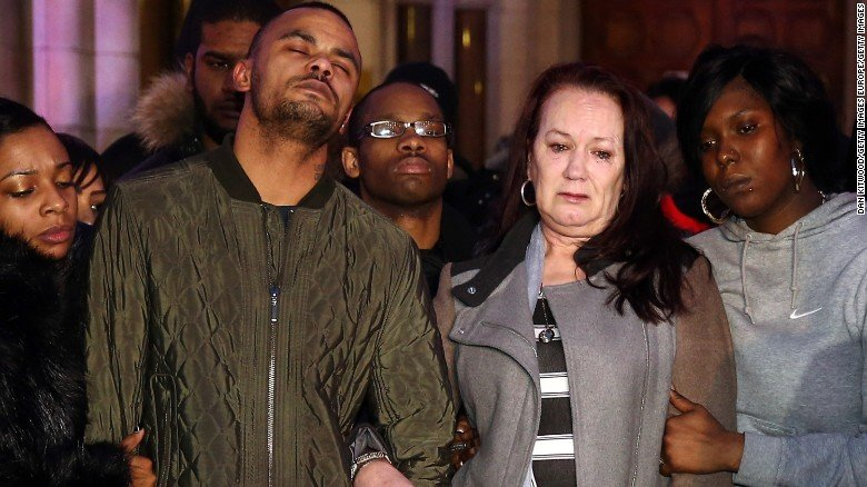 Mark Duggan's brother Marlon and mother Pam leave the Royal Courts of Justice in London after an inquest found Mark's death was lawful.