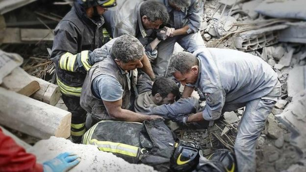 Rescuers workers struggled to free survivors from the rubble