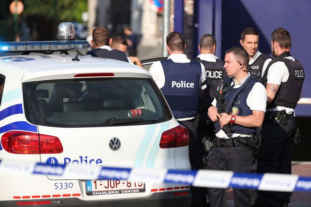 Police secure the area around a police building in Charleroi following a machete attack