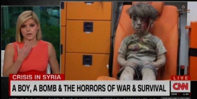 News Anchor Kate Bolduan Breaks Down While Sharing Video of Syrian Child Rescued From Bombing