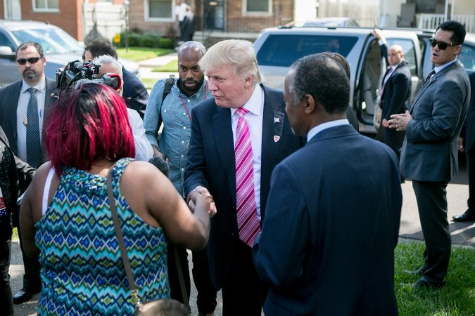 Mr. Trump and Ben Carson visit Felicia Reese, the current owner of Mr. Carson's childhood home, in Detroit.