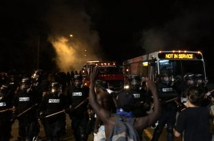 Charlotte, NC Police Fire Tear Gas at Protesters Hours After Man is Fatally Shot By an Officer