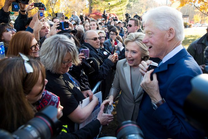 Hillary Clinton, with former President Bill Clinton, greeted people outside the polling station in Chappaqua, N.Y., after they voted Tuesday morning.