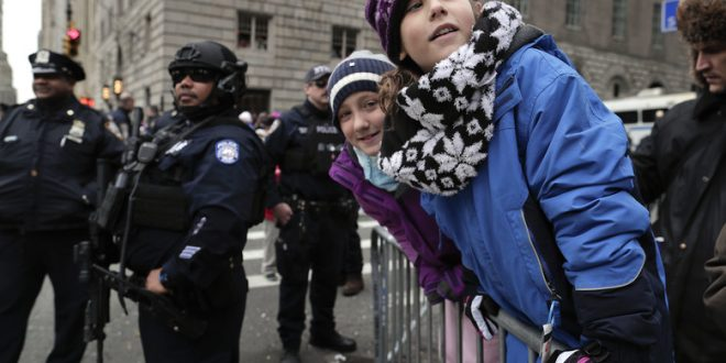 Revelers Cheer Amid Police at Macy's Thanksgiving Day Parade