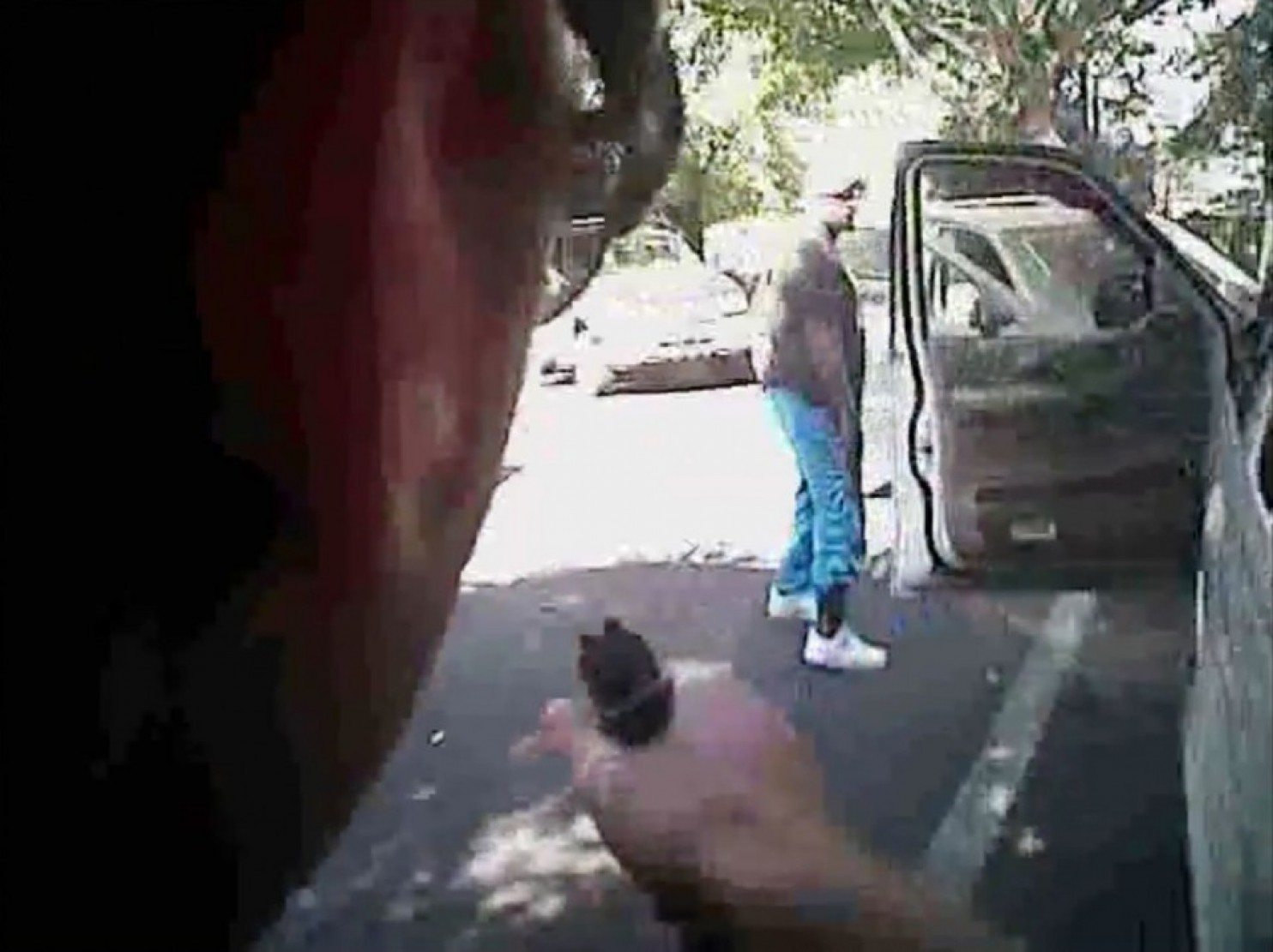 A still image from a video the Charlotte police released showing Keith Scott looking at officers with hands by his sides just before he was shot. (Charlotte-Mecklenburg Police Department via Reuters)