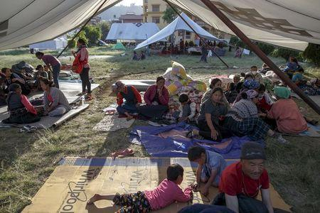 Survivors fight for helicopters close Nepal town that vanished