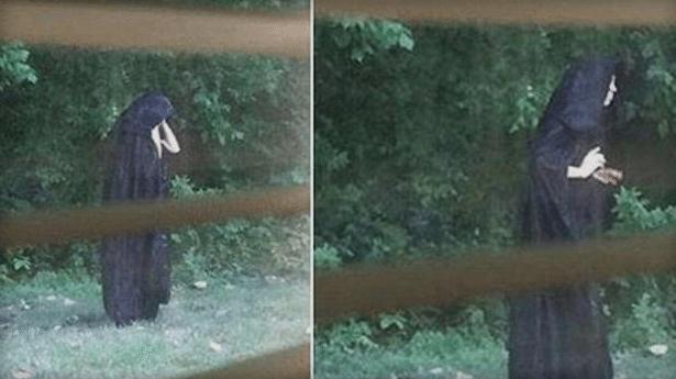Police Investigating after Images of Creepy Guy in Dark Cloak go Viral