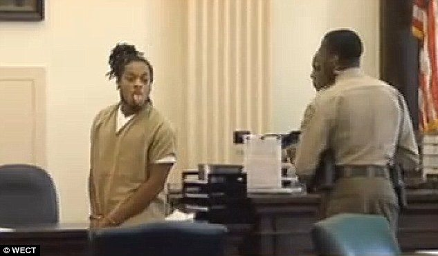VIDEO N.C. Murder Suspect Sticks Tongue Out at Victim's Family
