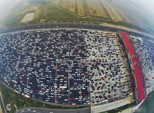 VIDEO Beijing, China: Thousands Left Stranded in 50-Lane Traffic Jam