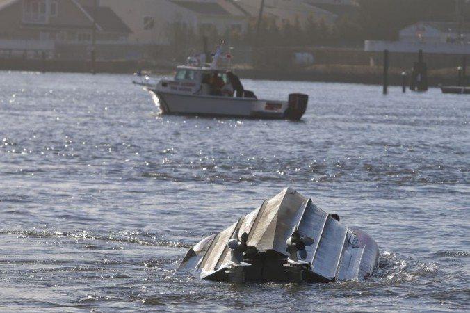 U.S. Coast Guard Boat Overturns in Far Rockaway, New york