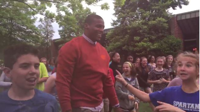 VIDEO Cam Newton Hops Fence to Play Football With 7th Graders