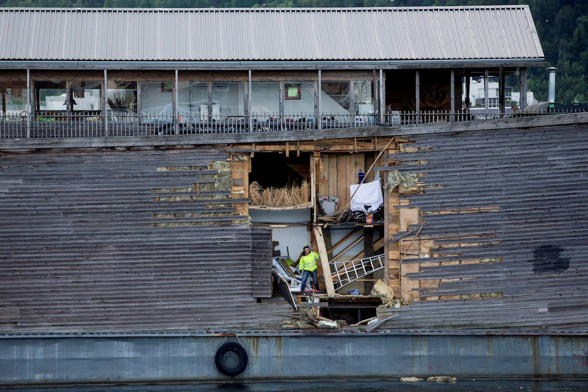 A crew member inspects damages on the hull of a full-size replica of the Ark of Noah after it crashed into a moored coast guard vessel in Oslo harbour, Norway June 10, 2016. NTB Scanpix/Hkon Mosvold Larsen/ via REUTERS