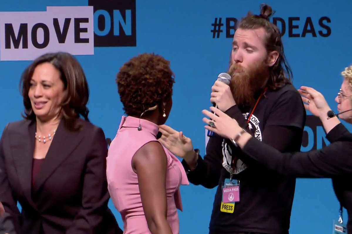 Protester Storms Stage, Grabs Mic From Kamala Harris at Event