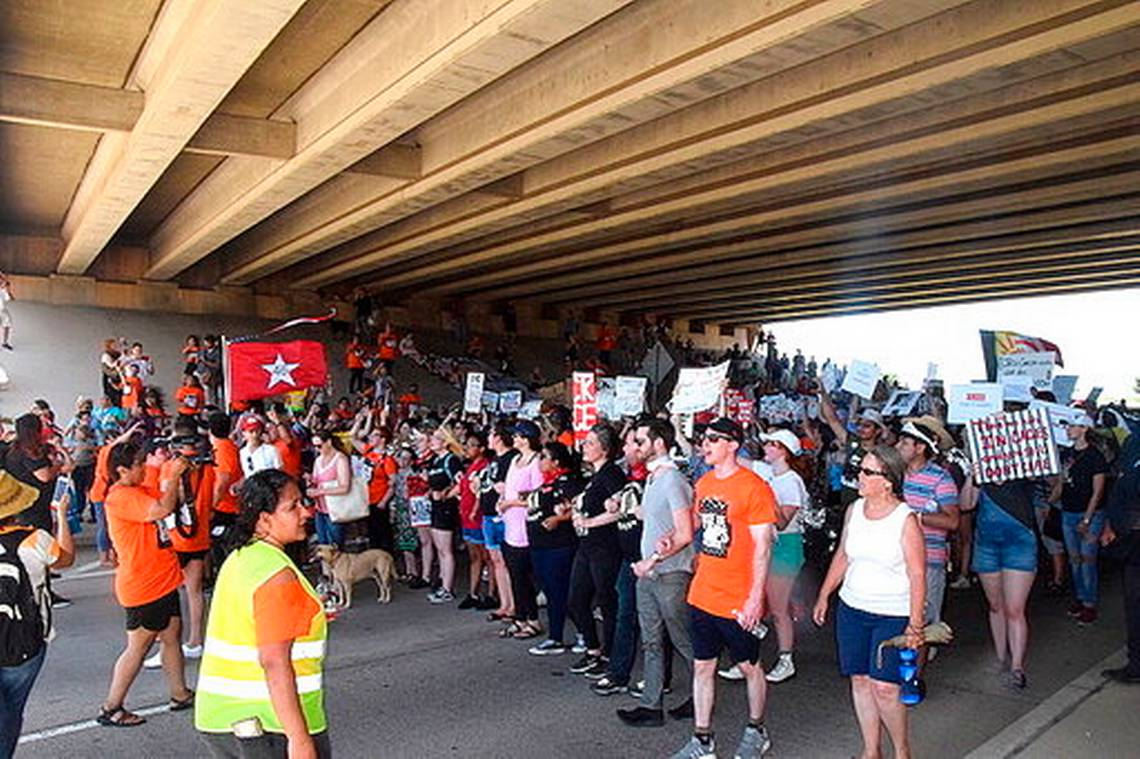 """""""Close the Camps!"""": Protesters March Lawton Streets in Opposition of Migrant Children at Fort Sill"""